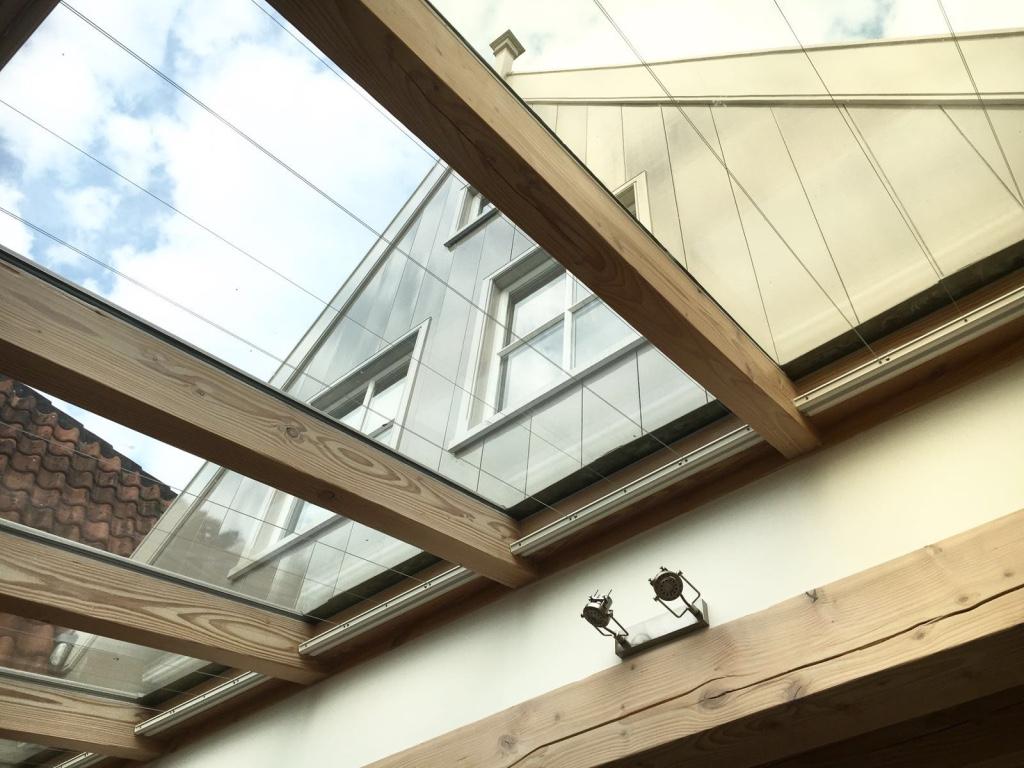 Woning uitbouw met glas
